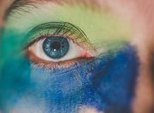 Human Eye With Blue and Green Makeup Stock Photography