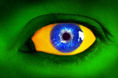 Human eye in colors of Brazilian flag. Stock Images