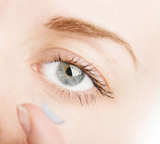 Human eye and contact lens Stock Photos