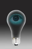 Human eye in light bulb Stock Image