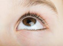 Human eye looking to up Stock Photos