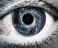 Human eye looking in Universe Royalty Free Stock Images