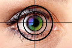 Human eye and target. Close-up of colourful human eye and target stock photos
