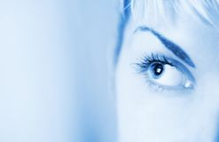 Human eye toned in blue. Picture of a Human eye toned in blue Stock Photography