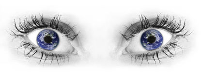 Human eyes. Black and white isolated human eyes with colored planet Earth reflection royalty free stock photos
