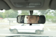 Human Face in the Car Mirror Stock Photo