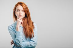 Human face expressions and emotions. Portrait of young desperate redhead woman in sailor shirt looking panic, holding her head with both hands, with mouth wide stock image