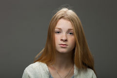 Human face expressions and emotions. Portrait of young adorable redhead woman in cozy shirt looking calm and happy. Royalty Free Stock Photography