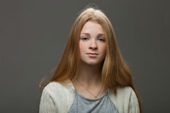 Human face expressions and emotions. Portrait of young adorable redhead woman in cozy shirt looking calm and happy. Royalty Free Stock Photos
