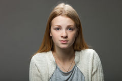 Human face expressions and emotions. Portrait of young adorable redhead woman in cozy shirt looking calm and happy. Stock Image