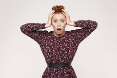 Human face expressions and emotions. Redhead lady looking desperate and panic, holding hands on her head, screaming with mouth wi stock photos