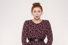 Human face expressions and emotions. Redhead young woman shocked stock photo