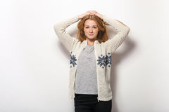 Human face expressions and emotions. Young adorable redhead woman in cozy shirt hands behind head with gorgeous red hair having. Fun against white studio wall stock image