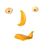 Human face imitation with dried fruits. Isolated on the white background Stock Photos