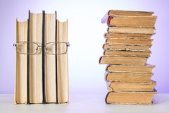 Human face made from some books with glasses, with pile of old shabby books. The concept of reading. Human face made from some books with glasses, with pile of royalty free stock images