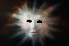 Human face mask protruding through fabric of space - extraterres. Trial life discovery concept. Elements of this image were furnished by NASA Stock Images