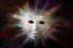 Human face mask protruding through fabric of space - extraterres. Trial life discovery concept. Elements of this image were furnished by NASA Royalty Free Stock Photos