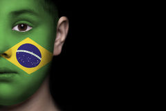 Human face painted with flag of Brasil Royalty Free Stock Image