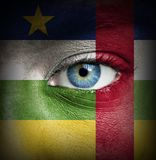 Human face painted with flag of Central African Republic stock photo