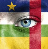 Human face painted with flag of Central African Republic stock image