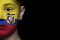 Human face painted with flag of Ecuador Stock Image