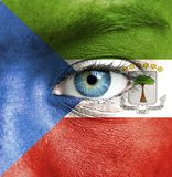 Human face painted with flag of Equatorial Guinea royalty free stock photography