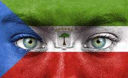 Human face painted with flag of Equatorial Guinea stock image