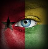 Human face painted with flag of Guinea-Bissau royalty free stock photos