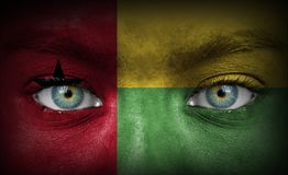 Human face painted with flag of Guinea-Bissau stock photography