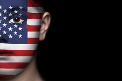 Human face painted with flag of USA Stock Photo