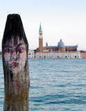 Human face pictured on the pier in Venice Royalty Free Stock Photo