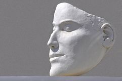 Human face shaped in white plaster Stock Photos