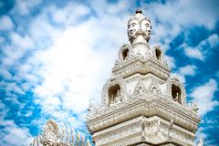Human face statue on rooftop of a temple. Ancient art, religion, landmark for travelling royalty free stock image