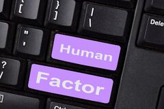 Human Factor write on keyboard isolated on laptop background