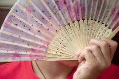 Human with fan. Human hides behind a fan Stock Photo