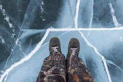 Human feet in boots on the ice Royalty Free Stock Image