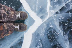 Human feet in boots on the ice Stock Photography