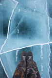 Human feet in boots on the ice Royalty Free Stock Photo