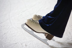 Human feet in fads standing on ice Royalty Free Stock Photos