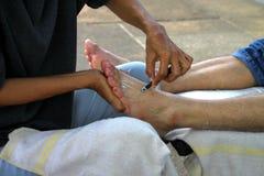 Human feet massage Stock Photos