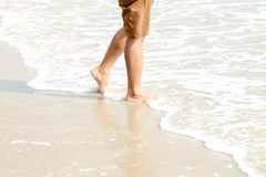 Human feet walking on the beach,tourist relax on summer holiday royalty free stock photo