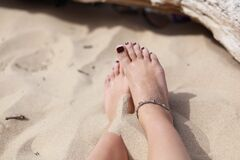 Human Feet on White Sand during Daytime Royalty Free Stock Images