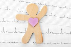 Human figure with heart on cardiogram. Top view royalty free stock image