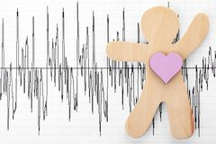 Human figure with heart on cardiogram, top view. Space for text stock photo