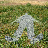 Human figure imprinted on grass Stock Photo