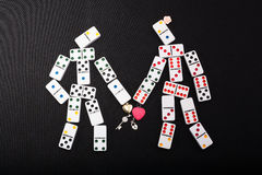 Human figures of dominoes Royalty Free Stock Images