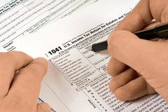 Human fills out the tax form royalty free stock photography
