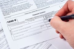 Human fills out the 1040-v tax form royalty free stock image