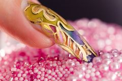 Human finger with acrylic fingernail and manicure Stock Images