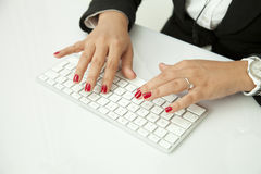 Human Finger on the Keyboard Stock Image